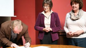 Signing agreement for Centre for Theology and Justice